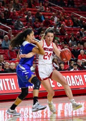 Ciara Duffy of USD dribbles the ball past Jaylyn Agnew of Creighton during their game on Wednesday night, Dec. 4, at the Sanford Coyote Sports Center in Vermillion.