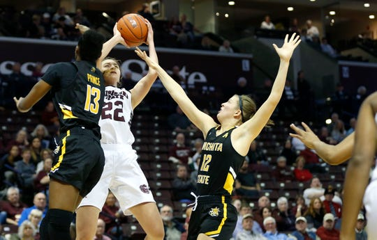 Missouri State Lady Bears senior Alexa Willard fades back as she shoots a field goal attempt as Wichita State's Raven Prince (13) and Carla Bremaud (12) attempt to stop the shot during a game at JQH Arena on Wednesday, Dec. 4, 2019.