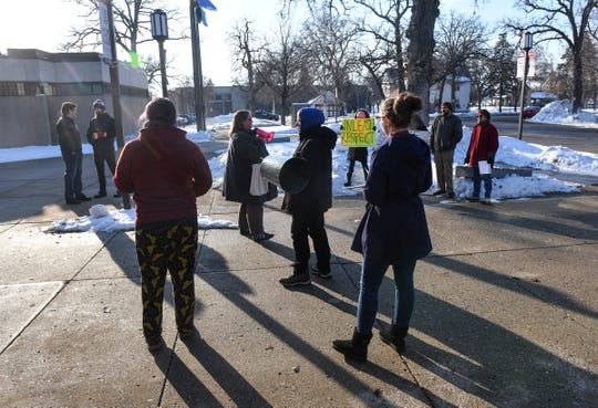 Protesters gather in front of the St. Cloud State University Administration Building Thursday, Dec. 5, 2019, in St. Cloud. Layoffs of eight faculty members are planned at the end of this school year.