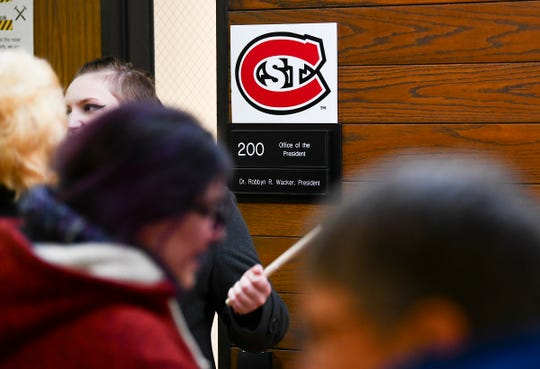 Protesters gather outside the office of St. Cloud State University President Robbyn Wacker Thursday, Dec. 5, 2019, in St. Cloud.