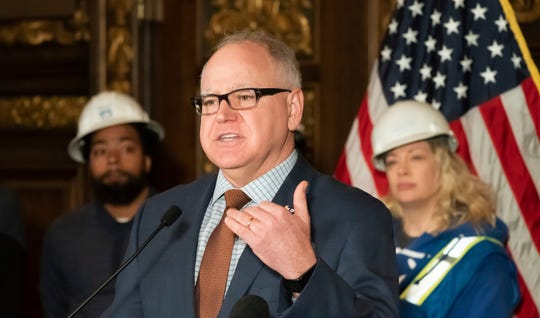 Minnesota Governor Tim Walz held a press conference Monday, March 4, 2019, to announce major energy and climate policy initiatives. Walz set an ambitious goal Monday for Minnesota to get 100 percent of its electricity from carbon-free sources by 2050. (Glen Stubbe/Star Tribune via AP)