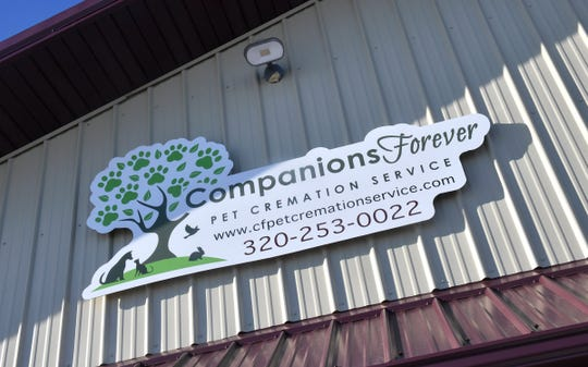 A sign marks the entrance to Companions Forever Pet Cremation Service Wednesday, Dec. 4, 2019, in Waite Park.