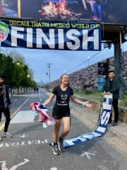 Laura Knoblach crosses the finish line in Leon, Mexico on Oct. 31, 2019, setting a world record for the women's double deca triathalon.