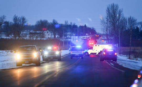 Emergency vehicles line the road near the scene of a reported helicopter crash Thursday, Dec. 5, 2019, near Marty.