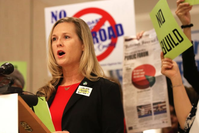 Lindsay Cross, government relations director with Florida Conservation Voters, voices her concerns regarding the proposed toll roads in the state of Florida during a press conference in the Capitol Rotunda.