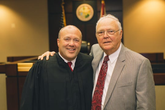Judge Layne Smith with his Dad at his investiture on May 29, 2015.