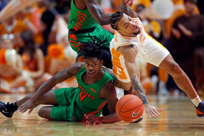 Tennessee guard Lamonte Turner, right, battles for the ball with Florida A&M guard Rod Melton Jr., left, during the first half of an NCAA college basketball game Wednesday, Dec. 4, 2019, in Knoxville, Tenn. (AP Photo/Wade Payne)