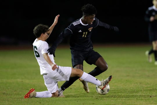 Florida High Seminoles Zuri Robertson (11) keeps the ball away from his opponent. The Florida High Seminoles hosted the Lincoln Trojans on Wednesday, Dec. 4, 2019.