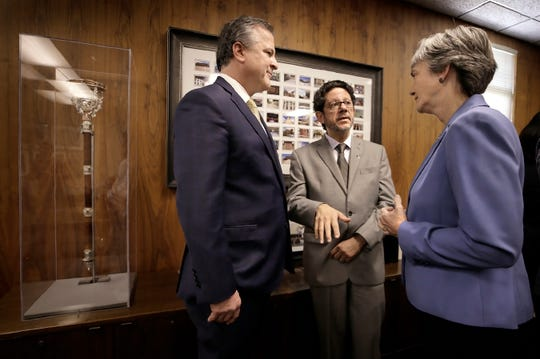 UTEP President Dr. Heather Wilson talks with Robert Kirken, PhD., Dean of the College of Science, left, and Igor Almeida, PhD., Professor of Biological Sciences, after announcing a milestone in reseach funding topping $100 million in 2019.