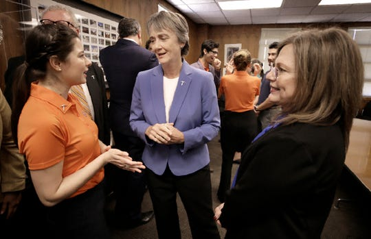UTEP President Dr. Heather Wilson talks with undergraduate reseach student Montserrat Garcia and Lourdes Echegoyen after announcing the university topping $100 million in research in 2019.