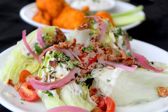 The Wedge Salad is ready to be eaten at the Ojai Pub.