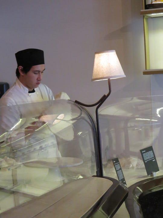 Matthew Weisshaar prepares dough at MidiCi Wood Fired Pizza in downtown Ventura.