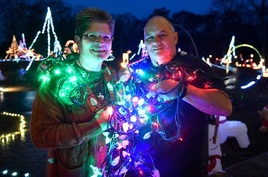 Pete and Missy Lawlor of Pittsgrove have one of the biggest drive-through Christmas displays in the area, featuring over 90,000 lights synced to their radio station.