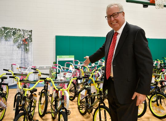 Volunteers with Ron Jaworski's foundation assemble 200 bikes at the Vineland YMCA on Thursday. The bikes will be distributed to at-risk youth in Cumberland County.