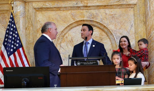 N.J. Senate President Stephen M. Sweeney  (left) administers the oath of office to Vinelander Michael L. Testa Jr., elected as part of a Republican sweep of the 1st Legislative District race in November 2019. Testa's wife Julie and their two daughters and son were present.