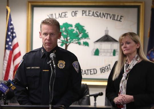 Pleasantville Police Chief Erik Grutzner speaks as Pleasantville School Superintendent Mary Fox-Alter looks on during a news conference on the deaths of a family of four in Pleasantville on Dec. 5, 2019.