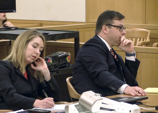 Assistant New York Attorney General Brian Weinberg, right, listens to opening arguments in the Lawrence Porcari trial in Westchester County Court in White Plains on Thursday, December 5, 2019.