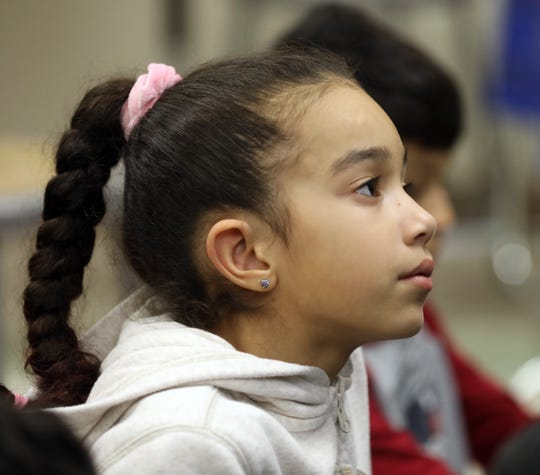 Student Alyssa Pedersen listens to a teacher from China at a meeting of the One World Club at Park Avenue School in Port Chester on Dec. 4.