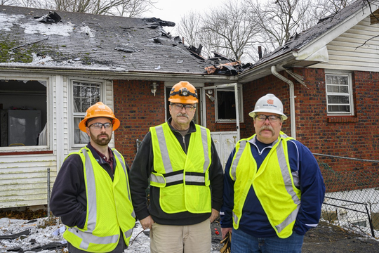 O&R employees James Lynch, Ross Dailey and Ted Ryder at the scene of yesterday's house fire in Monsey where Ryder and Lynch rescued an elderly man from the burning building.