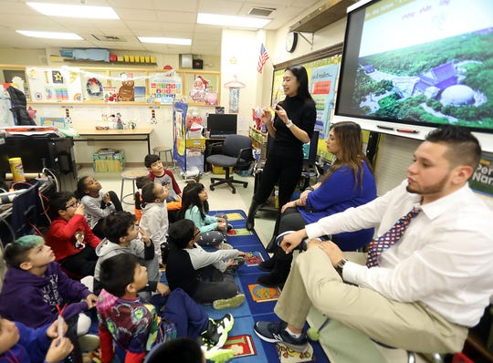 A teacher from China teaches Mandarin to students of the One World Club at Park Avenue School in Port Chester on Dec. 4. The club has helped reduce carbon emissions, earning recognition from the United Nations.