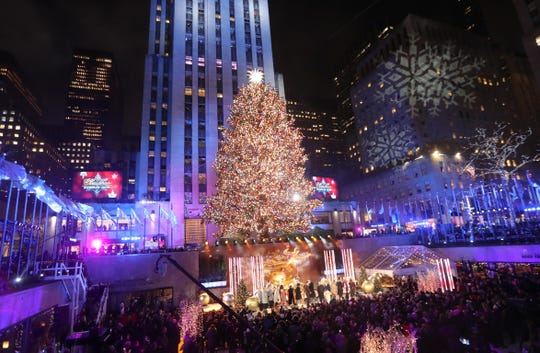 The Christmas Tree is lit at Rockefeller Center during the Rockefeller Center Christmas Tree Lighting Ceremony in Manhattan Dec. 4, 2019.
