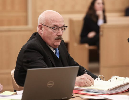 Attorney Stephen Lewis, for his client, former coporation council for the City of Mount Vernon, Lawrence Porcari, sits in Westchester County Court in White Plains on Thursday, December 5, 2019 preparing to give opening statements.