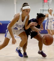 Isabella Aliaj of Saunders battles Paige Adams of Roosevelt during a varsity girls basketball game at Saunders High School in Yonkers Dec. 5, 2019. Saunders defeated Roosevelt 43-27.