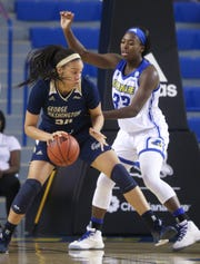 Delaware's Nicole Enabosi (right) defends as George Washington's Kayla Mokwuah works in close in the first half at the Bob Carpenter Center Wednesday.