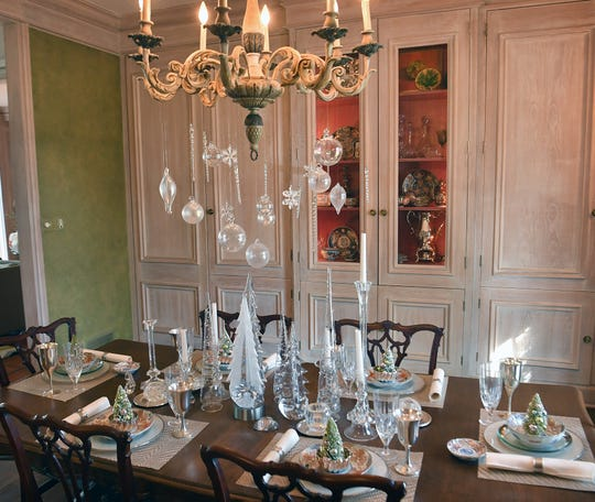 A dining room decked out with family heirloom pieces is part of the Christmas flavor at Tod and Courtney Waggoner's house on the 2019 Christmas Tour of Homes.
