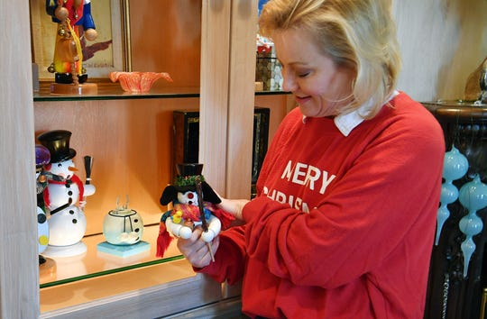 Courtney Waggoner talks about her collection of nutcrackers and incense smokers as she decorates for the Christmas Tour of Homes presented by the Woman's Forum.
