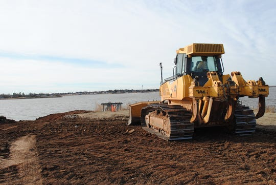 Dirt-moving equipment is seen Thursday morning about construction of the boardwalk at Lake Wichita. Trinity Hughes construction is working on the $1.2 million project, which is scheduled to be complete this spring.
