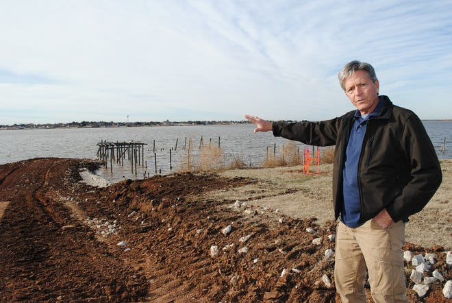 David Coleman, chairman of the Lake Wichita Revitalization Committee talks Thursday morning about construction of the boardwalk at Lake Wichita.