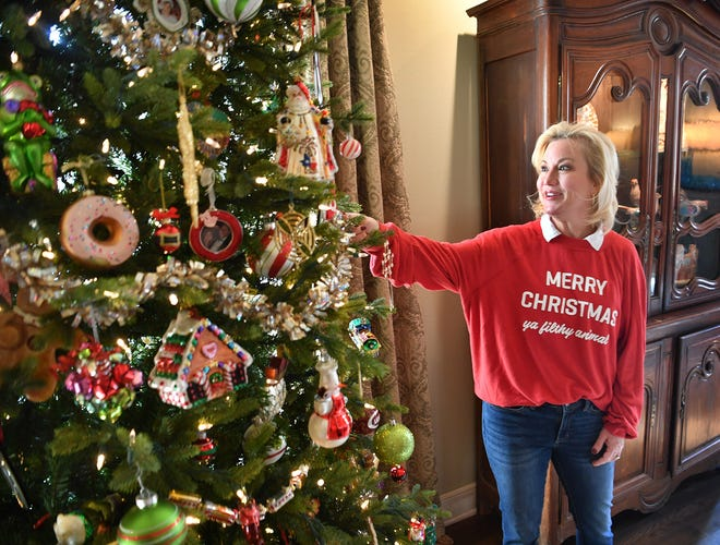 In this 2019 file photo, Courtney Waggoner talks about the family heirloom ornaments on one of her Christmas trees. Her house was a stop on the Women's Forum Christmas Tour of Homes. The Senior Junior Forum announced the cancellation of the 2020 Tour of Homes due to the pandemic.