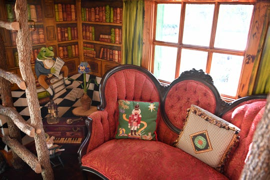 A cozy reading nook was created with antique furniture and whimsical artwork by Jane Spears Carnes inside the magical playhouse at Toddy and Courtney Waggoner's home.