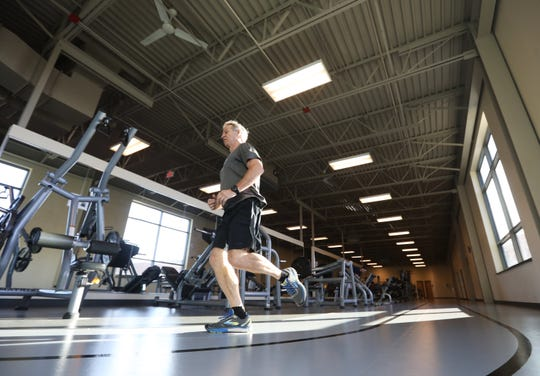 Jim Scott, 67, takes a lap around the track at the Muskingum Family YMCA in Zanesville on Thursday. Scott is one of 12 area residents chosen  for the 2020 Southeast Ohio 60 Strong calendar, which promotes active living for seniors.