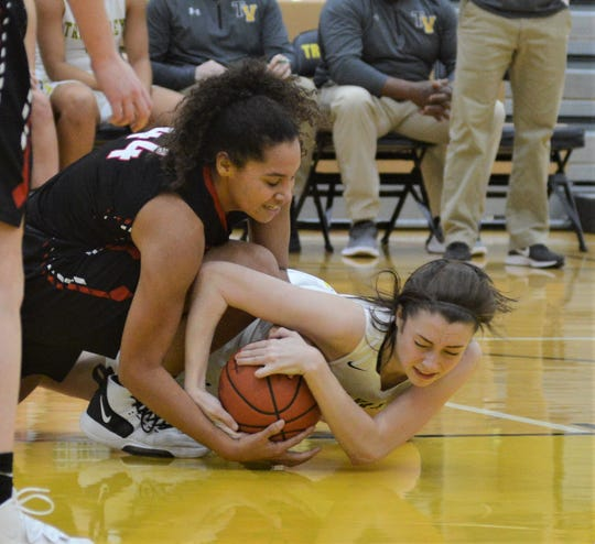 Tri-Valley's Janie McLoughlin and New Philadelphia's Ajiia Schreffler (44) battle for a loose ball in Wednesday's game. The Scotties won 44-34.