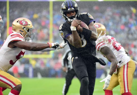 Baltimore Ravens quarterback Lamar Jackson scores a touchdown in the second quarter against the San Francisco 49ers at M&T Bank Stadium.