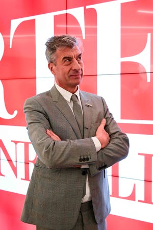 "Italian artist Maurizio Cattelan poses during the launch of ""Arte Generali"" by Italian insurance company Generali on Nov. 12, 2019 in Milan."