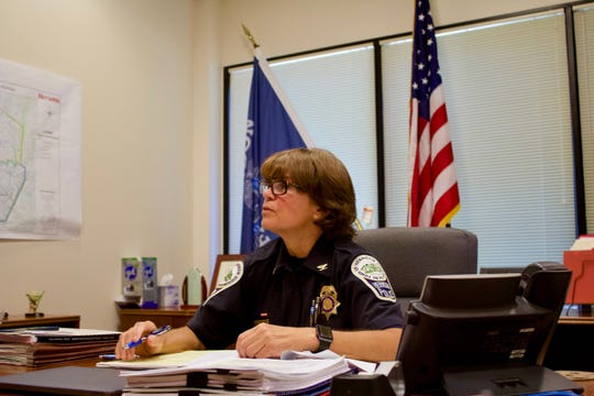 Herndon Chief of Police Maggie DeBoard sits in her office at the police station.