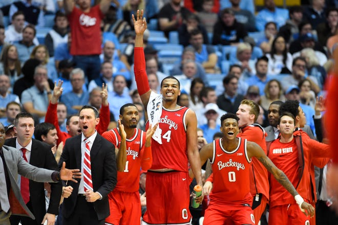 The Ohio State Buckeyes bench celebrates in the second half at the Dean E. Smith Center.