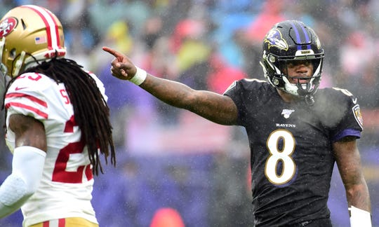 Lamar Jackson signals a first down during the Ravens' Week 13 win over the 49ers.