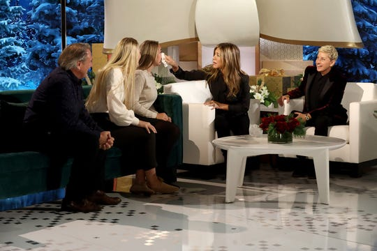 """Jennifer Aniston dries the tears of Elyse Kimball, next to Jeff and Lexi Kimball, on """"Ellen's Greatest Night of Giveaways."""""""