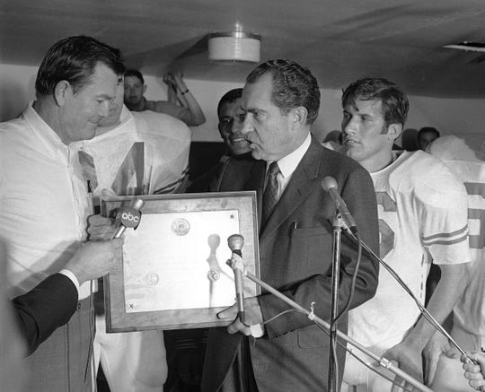 President Richard Nixon presented a plaque to Texas coach Darrell Royal, naming the Longhorns the No. 1 college football team after their victory against No. 2 Arkansas on Dec. 6, 1969.