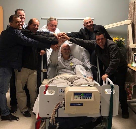 Ozzie Zenger (center, in bed) being visited by friends at Kessler Institute for Rehabilitation in West Orange
