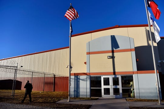 Marc Moore, the Dallas field office director for U.S. Immigration and Customs Enforcement's (ICE) Enforcement and Removal Operations, takes a phone call outside of the Bluebonnet Detention Center (BBDC) in Anson, Texas Tuesday Dec. 3, 2019. ICE's newest detention facility is scheduled to house up to 1,000 detainees starting this week.