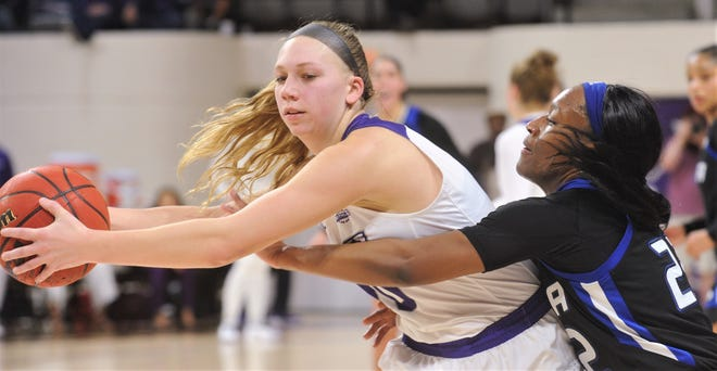Tulsa's Morgan Brady, right, tries to knock the ball away from ACU's Breanna Wright in the second half. ACU beat the Golden Hurricane 73-63 in a nonconference game Dec. 5 at Moody Coliseum.