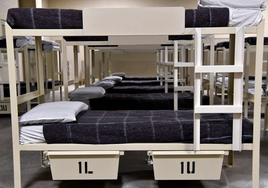Bunk beds are lined in a row inside a dormitory at the U.S. Immigration and Customs Enforcement's Bluebonnet Detention Center in Anson on Dec. 3 shortly before the 1,000 bed facility opened to house detainees.