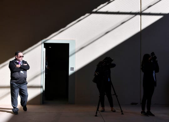 Reggie Sakamoto, the director of operations for Management and Training Corporation (MTC), walks through a covered recreation area during a media tour of the Bluebonnet Detention Center (BBDC) in Anson Tuesday Dec. 3, 2019. MTC will manage the facility which is slated to begin receiving detainees from U.S. Immigration and Customs Enforcement (ICE) this week.