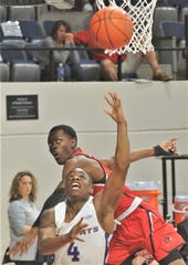 ACU's Damien Daniels (4) drives past a Southeast Missouri State defender for a shot in the first half.
