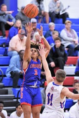 Cooper's Noah Garcia (3) takes a shot against Midland Christian in the quarterfinals of the Raising Cane's Key City Classic Star Bracket quarterfinals at Cougar Gym on Friday. Garcia scored 14 points in just his third game with the team after the football season.